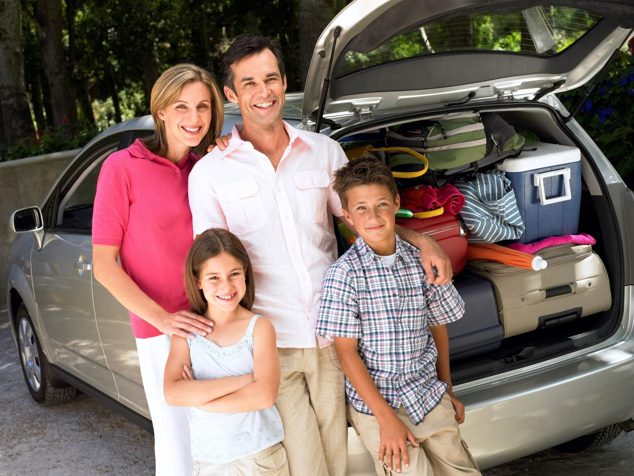 are we there yet travel tips family in front of car image