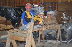 <em>Mike Foster from First Baptist Church Birmingham cutting support structures in the rebuilding of Roaring Forks Baptist, Gatlinburg, Tenn.</em>