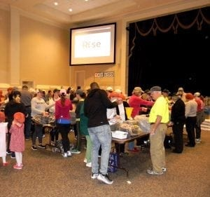 <em>Volunteers of all ages worked together to pack more than 300,000 meals last month at Canterbury UMC.</em>