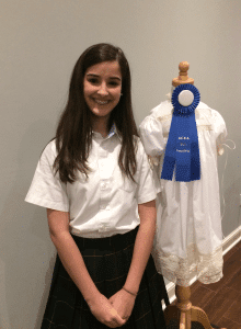 <em>Glen Iris Baptist School (GBIS) Junior Sara Young with the heirloom dress she designed and entered in the Alabama Christian Education Association (ACEA) Fine Arts competition winning first place in Garment Construction. She advances to the national competition this spring.</em>