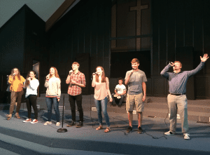 <em>Kingwood senior Cade Horton (far right) has been a part of the school's Praise and Worship Team since 6thgrade. The group leads worship every Thursday morning during chapel services.</em>