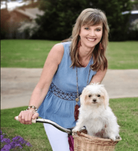 <em>Missy and Mia Robertson will release books three and four of the Princess in Camo series in early September. Dog Show Disaster features famous lap dog Hazel Mae, seen here on a bike ride with Missy.</em>