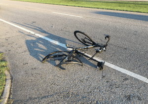 <em>While riding his bike June 26, 2017, Thomas Waters was struck by a hit and run driver in Irondale. Fellow cyclists, Al Schlosser and Rex Seaborn, helped Waters to safety.</em>