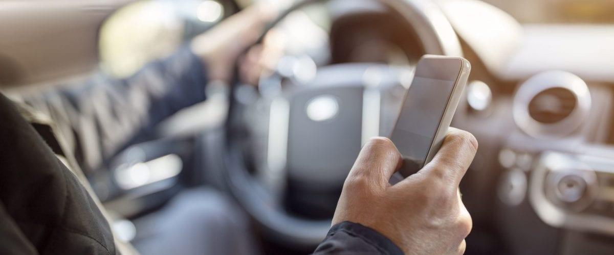 bigstock-Using-a-phone-in-a-car-texting-155269526
