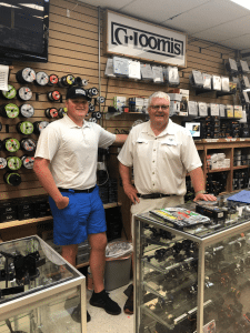 """<em>Mark's Outdoors Jacob Walker and John """"Opie"""" Norris help customers find the rod, reel and tackle best suited for them.</em>"""