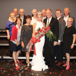 <em>Miss Alabama 2018 told Birmingham Christian Family that while she didn't cry on stage after her win, she lost her composure when she saw grandfather Howard Plott, known as Poppa (behind Callie), ready for family pictures backstage. Also pictured are Plott's wife, Bettye; and grandparents Karen and C.H. Walker, whose commitment to community service inspired Callie from a young age; parents Angela and Mike; and twin brother, Michael (third from left). While Callie was being crowned Miss Alabama, older sister Scarlett was in New York City performing on Broadway. Photo Courtesy The Miss Alabama Pageant.</em>