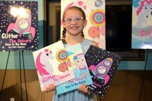 Eight-year-old Callie Chapman has written three books, Glitter the Unicorn, Glitter the Unicorn Goes to the Beachand Glitter the Unicorn Goes to the Moon. She will be a fourth grader this fall at Crestline Elementary.