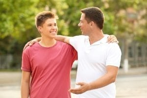 bigstock Teenager boy with father in pa 209063731