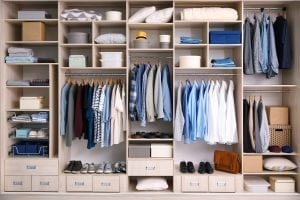 bigstock Big wardrobe with male clothes 227186326