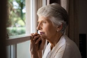 bigstock Depressed senior woman at home 259489585