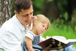 bigstock Father and daughter reading 33993602