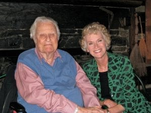 "Ruth Graham is seen here spending time with her father Rev. Billy Graham who died one year ago this month, February 2018.  She says a favorite family story from her father's life is of the day he walked into a forest to confess doubt and make a vow to God. ""He put his Bible on the stump of a tree and said, 'Lord, I don't know all there is in this Bible, but I'm going to believe that it's true. By faith, I'll believe that it's true.' He did from that day forward. He never questioned it."""