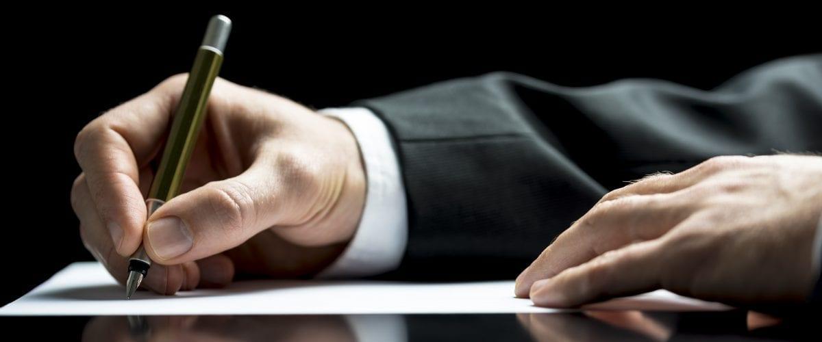 bigstock Businessman Writing A Letter O 57436670