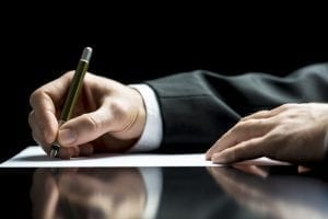 bigstock Businessman Writing A Letter O 57436670