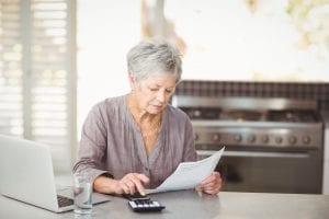 bigstock Senior woman using calculator 167417714