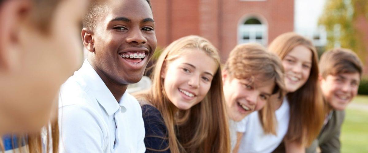 bigstock Group Of Teenage Students Sitt 219305932