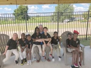 CEO of the Presbyterian Home for Children (PHFC), Doug Marshall, is seen here with some of the children the ministry serves.