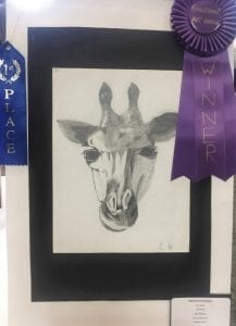 Prince of Peace Eighth grade student Nick Hernandez's drawing of a giraffe won the best of the best at the diocesan art show and is on display in the Diocese of Birmingham's office.