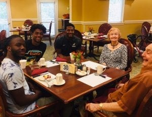 Brookdale University Park Senior Living residents and Samford students enjoy a morning together.