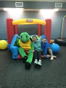 """IsabellaPowell and her brother David, age 10, enjoying the Calera Intermediate sensory room. Powell says, """"Seeing my brother rise from first making D's and F's to now making A's in school seems like a dream come true."""""""