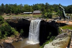 summer resource guide noccalula falls with statue of noccalula