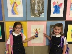 OLS students enjoying the special display of artwork during the 2019 Art Show.