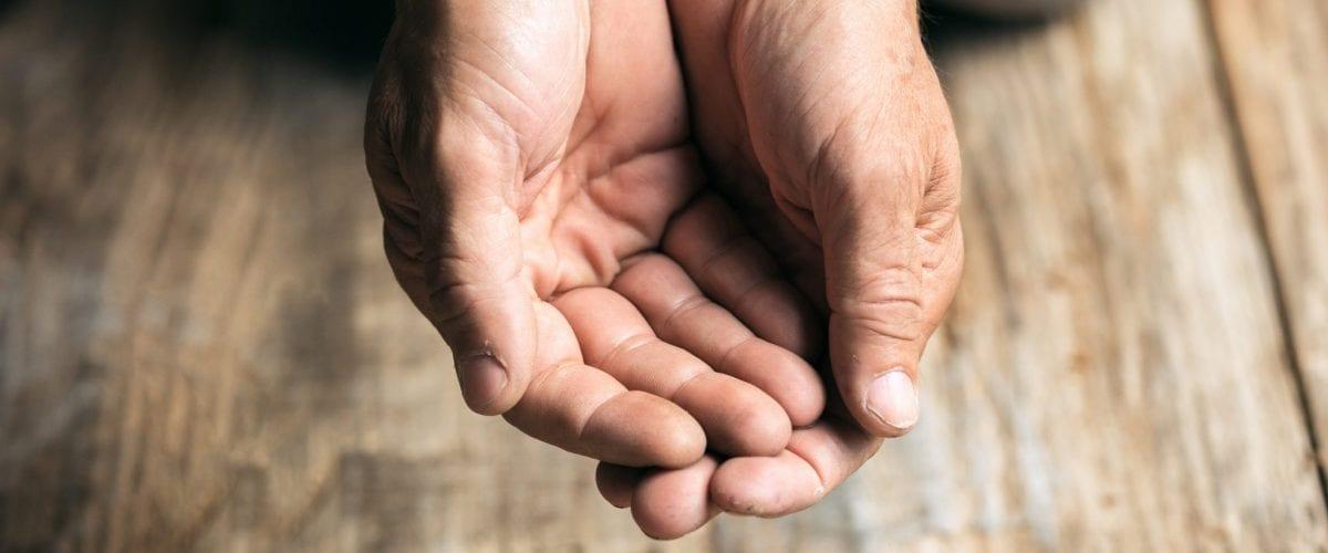 bigstock Male Beggar Hands Seeking Mone 306078415