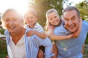bigstock Portrait Of Smiling Grandparen 260598928