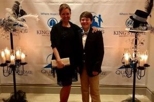 Kings Home Queens Ball mom and son kings home backdrop