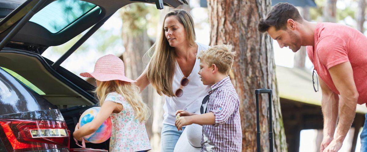 bigstock Family and children load car w 289158649