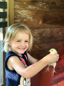 Betsy with a chick at Camp McDowell