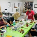 A Group of friends around a table creating art at Dixon Creative