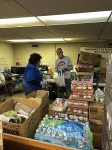 "Volunteers sorting food for ""I Cared Enough"""