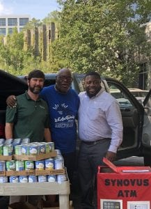 Mission makers Daniel Cason Ministries canned goods for Bread of Life from Synovus employees Cason center