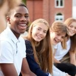 bigstock Group Of Teenage Students Sitt 219305932