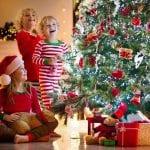 bigstock Child Decorating Christmas Tre 330421507