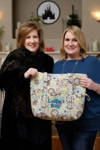 Laurie and Cheryl holding the grandmother tote