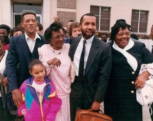 Walter McMillian with family and Bryan Stevenson