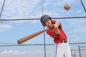 bigstock Young batter hitting the ball 297519895