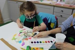 Girl painting at Dixon Creative