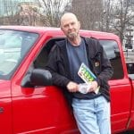 William Roberts Beside His Red Truck