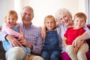 Grandparents sitting with grandchildren