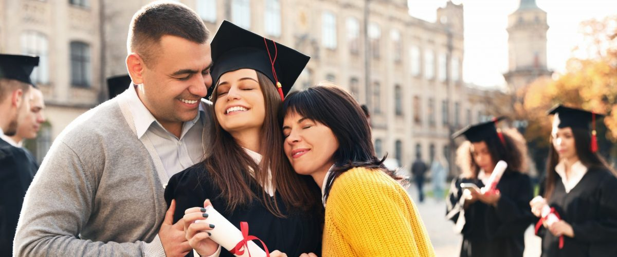 bigstock Happy Student With Parents Aft 329608783