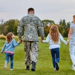 bigstock Back View Soldier s Family Wal 237308476