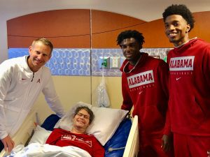 Chris Stewart in hospital with Alabama Basketball coach and players
