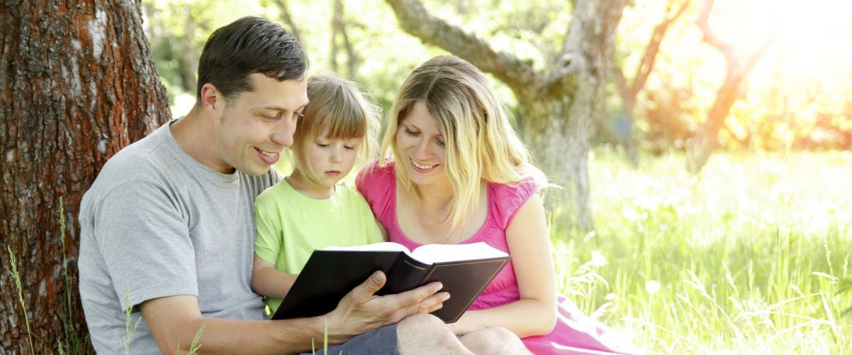 bigstock Happy Family Reading A Book On 420096673