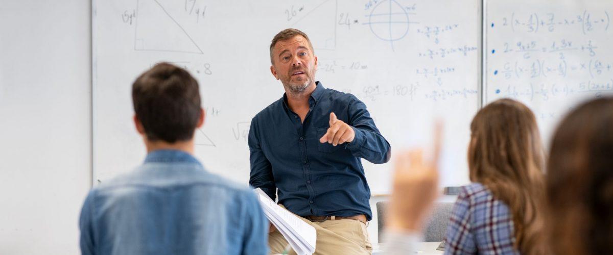 bigstock Professor pointing at college 390488804
